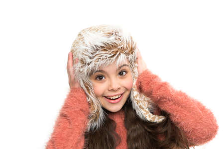 artificial fur fashion style. little playful girl in winter look smiling. Fashion concept. cute beauty isolated on white. warm in any weather. let it snow. ski resort. get ready for winter holiday Stock Photo