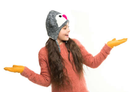 wow. homemade knit. little playful girl in winter look smiling. Fashion concept. cute beauty isolated on white. warm in any weather. let it snow. ski resort. get ready for winter holiday Stock Photo