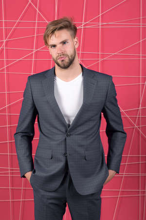Man well groomed manager wear elegant formal suit pink background. Manager confident wear perfect outfit. Guy office worker handsome appearance. Guy unshaved office manager. Manager dress code