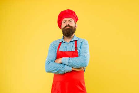 Confident chef in professional uniform restaurant cook readily providing dish 版權商用圖片