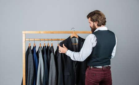 Man buy clothes fashion store menswear suit tuxedo, luxurious wardrobe concept