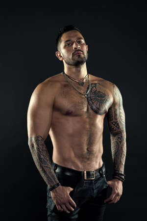 Sport and fitness. Masculinity. Muscular torso. Tempting glance. Bearded man with tattooed torso. Macho torso. Fit model with tattoo art on skin. Sportsman or athlete with beard and hair