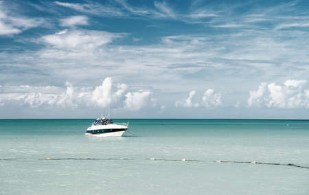 Attractive bright view of exotic colorful beautiful marine beach with boat on blue water 免版税图像