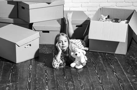 Spectacular Views in Every Direction. happy little girl with toy. Cardboard boxes - moving to new house. happy child cardboard box. playing into new home. new apartment. purchase of new habitation Banque d'images