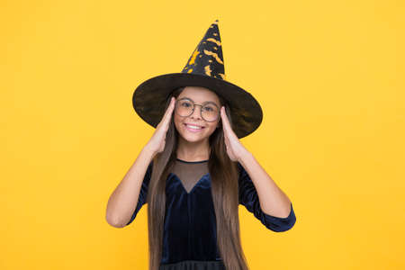 kid goes to wizard school. witchcraft and enchantment. childhood autumn holiday. girl ready to celebrate. costume party fun. happy halloween. smiling child in witch hat and glasses