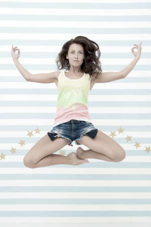 Woman fit slim lady posing as meditating while jump mid air. Healthy lifestyle keep you in good mood. Lady fit healthy look good. Fitness lifestyle benefits and advantages. Yoga meditating skill