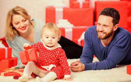 father, mother and doughter child. Shopping online. Take my heart. Valentines day. Red boxes. Happy family with present box. Love and trust in family. Bearded man and woman with little girl