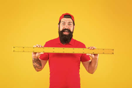 Perfect size. Bearded man with big measuring instrument. Measuring with ruler. Size measurement. Measuring length. Size clothes. Student study stem disciplines. Ruler tool equipment. Shop assistant