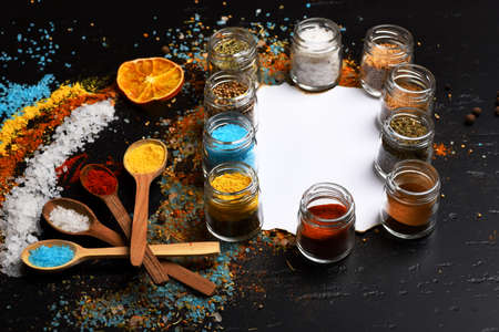 Set of spices on grey background. Food art concept. 免版税图像