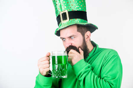 Green beer mug. Drinking beer part of celebration. Irish pub. Alcohol consumption integral part saint patricks day. Discover culture. Irish tradition. Man brutal bearded hipster drink pint beer