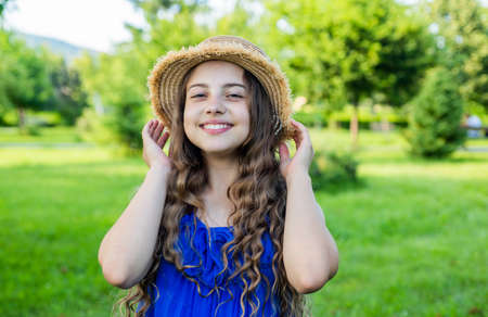Optimistic smiling girl enjoying sunny summer day in park Reklamní fotografie