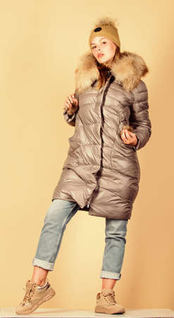 Buy winter clothes. Fashion boutique. Faux fur. Girl wear warm jacket. Shopping concept. Black friday. Sale and discount. Woman shopping try winter clothes. Shopping guide. Personal stylist service