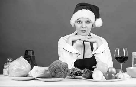 Woman chef santa hat cooking at kitchen. Best christmas recipes of perfect housewife. Christmas dinner idea. Cooking for family. Healthy christmas holiday recipes. Easy ideas for christmas party