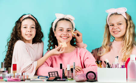 Cosmetics for children. Cosmetics shop. Young skin care. Best friends. Cleanse carefully. Beauty and fashion. Girls doing makeup together. Sisterhood happiness. Kids makeup. Skin care concept