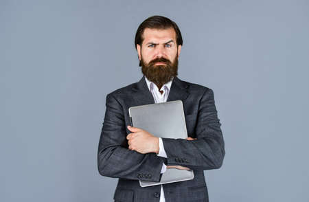 this is my computer. handsome ceo hold computer. boss and employee. agile business. online education concept. go shopping online. confident businessman with laptop. brutal male with beard in suit