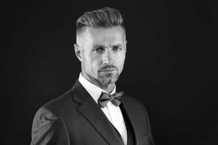 Handsome fashion model. handsome event manager. tuxedo man on black background. perfect male. fashion and beauty. aesthetic development concept. ready for special date. elegant man in formal outfit