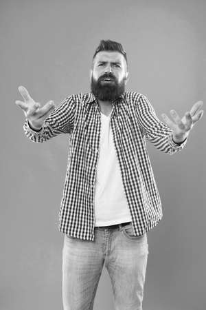Who are you. Depreciation and neglect. Disregard and disrespect. Bearded hipster brutal person. Bully hipster concept. Arrogant rude hipster man. Communication and gesturing. Expressive manners Foto de archivo