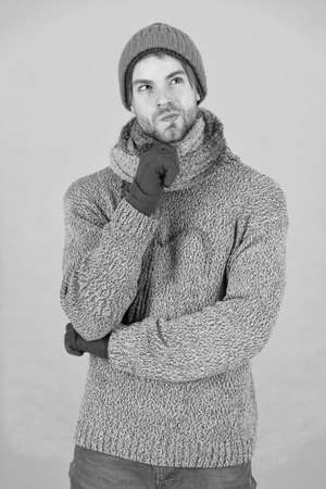 what weather is it today. guy wear warm clothes. male knitwear fashion. men knitted cloth and accessory. male blue background. poor homeless man. thinking man feeling cold in winter. no flu