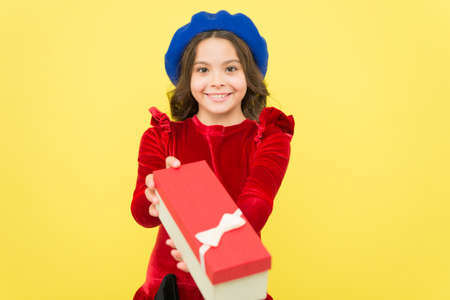 just take it. seasonal sale and discounts. happy birthday. retro kid fashion style. positive girl in vintage beret with gift box. trendy parisian child holding present. smiling teenager go shopping