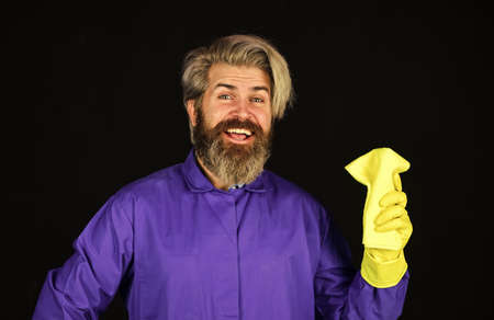 Good idea. handsome man with washing gloves. Morning hygiene. Husband housekeeping and cleaning concept. House cleaning. bearded man doing housework and cleaning
