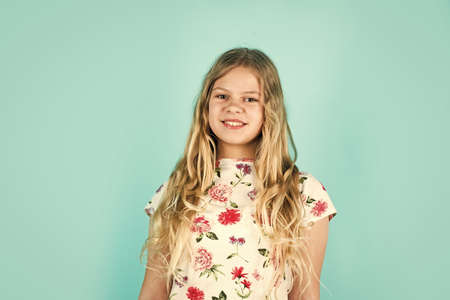 small girl with long blond hair. fashion model kid has blonde hairstyle. hairdresser for child. shampoo cosmetic for hair. happy childrens day. little beauty with stylish look
