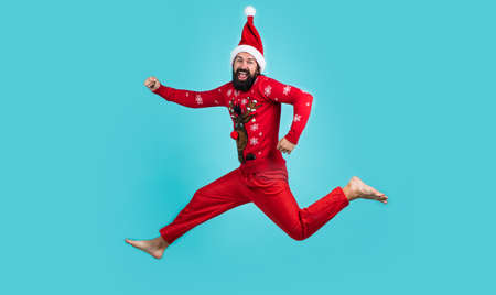 happy bearded man in red santa claus costume running and feel happiness about christmas shopping sales, new year celebration