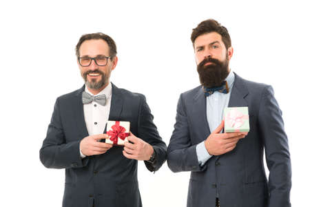 success and reward. esthete. businessmen in formal suit on party. bearded men hold valentines present. business partners on meeting isolated on white. happy birthday shopping. happy businessmen Banco de Imagens