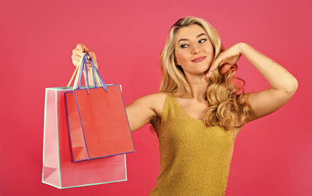 best give-away ever. special offer just for you. gifts and presents of any taste. shopaholic. closeout and bargain sale in shop. cyber monday concept. sexy blond woman go shopping. Pleasant shopping 版權商用圖片