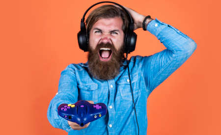 oh no. concept of tv gaming. man in headphones with console. hobby. just have fun. new technology in modern life. happy gamer play computer games. man playing video games. online game