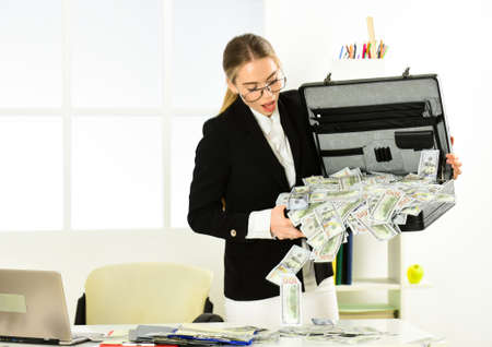 confident millionaire check money. economy and finance. rich bank worker. investment in yourself. businesswoman with office bag. successful woman got lot of money. she make dollars 免版税图像