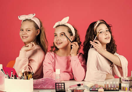 they are really cute. friendship party with cosmetic. relax and having fun. small girls in beauty salon. little sisters in retro fashion headscarf. makeup for kids. group of happy friends at spa Stock fotó