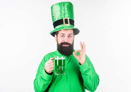 Man brutal bearded hipster drink pint beer. Irish pub. Green beer mug. Drinking beer part celebration. Bar seasonal holiday menu. Alcohol consumption integral part saint patricks day. Irish tradition