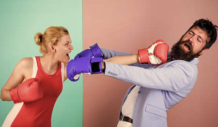 victims. knockout punching. who is right. win the fight. problems in relationship. sport. bearded man hipster fighting with woman. Strength and power. family couple boxing gloves