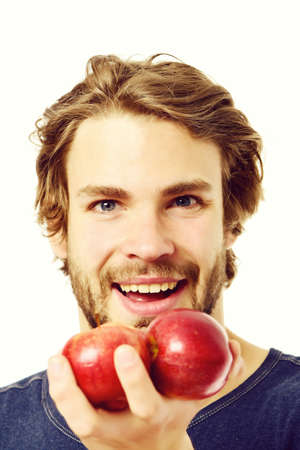 Man with happy and smiling face holding red apples
