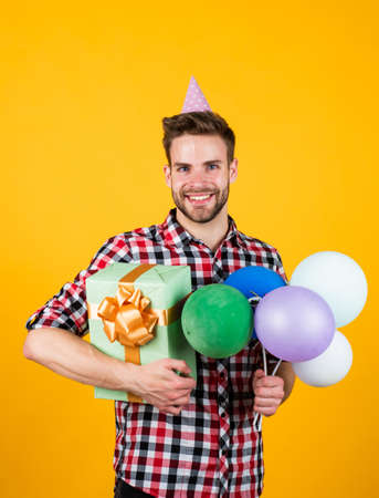 handsome cheerful young man with smile having fun on party. people and joy. birthday and celebration concept. real happiness. crazy party man on happy holiday. fathers day concept