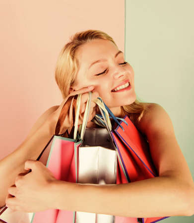 Addicted shopaholic girl. Black friday concept. Expert in shopping. Retail and consumerism. Shopping therapy. Buy gifts. Woman on shopping tour. Discounts and loyalty program. Girl with paper bags