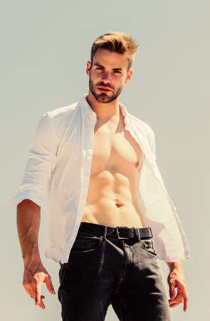 male sexuality. Bearded guy casual style. Handsome man fashion model. muscular man sexy torso. strong belly of athlete. fitness trainer. sport is healthy life. body desire. sexy macho man