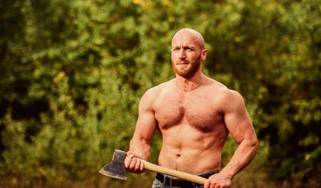 Man brutal sexy carry axe. Brutality is new sexy. strength and power concept. Masculine leisure. sexy macho bare belly ax. Handsome shirtless man with muscular body. muscular man with axe Reklamní fotografie