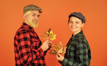 Fall season. Autumn leaves. Farmer family concept. Autumn is coming to our village. Farmers market. Autumn mood. Couple in love checkered rustic outfit. Retro style. Cheerful smiling couple dating