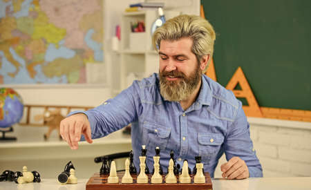 Do your own thinking independently. Chess lesson. Strategy concept. School teacher. Board game. Smart man playing chess. Intellectual hobby. Figures on chess board. Thinking about next step