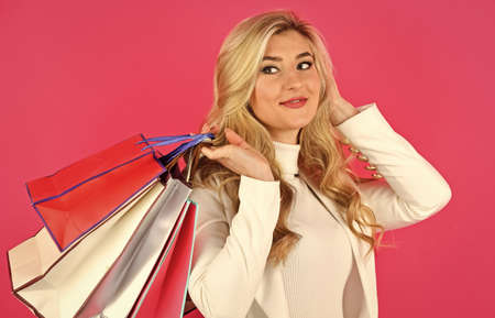 cyber monday concept. sexy blond woman go shopping. best give-away ever. special offer just for you. gifts and presents of any taste. shopaholic. closeout and bargain sale in shop. It is bargain