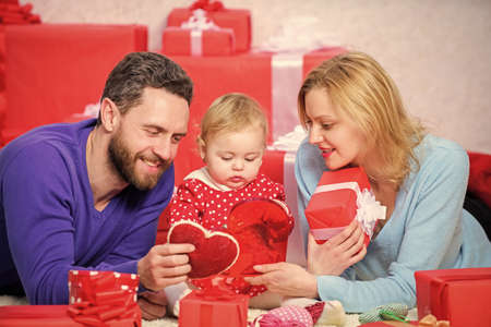 Couple in love and baby daughter. Valentines day concept. Together on valentines day. Lovely family celebrating valentines day. Happy parents. Life can not be better. Family celebrate anniversary