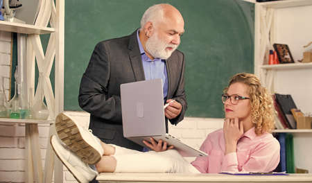 Modern school. High school college university. Communicate clearly and effectively. Teaching private lessons great way share knowledge. Man mature school teacher and carefree girl student with laptop