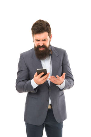 bearded businessman in formal suit. man speaking on phone. Typing a message. angry man