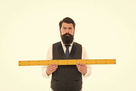 Measuring a line. back to school. bearded man hold ruler isolated on white. Teacher holding metric ruler. preparing for maths and geometry lesson. mature man with big measuring instrument Stock fotó