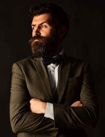 Man in retro suit and vest on brown background 免版税图像