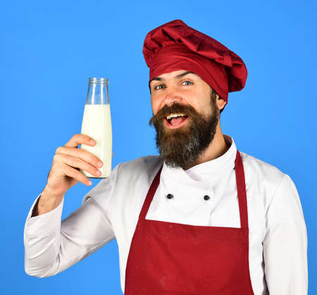 Nutritious lactose concept. Man with beard holds glass milk bottle