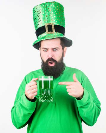 Alcohol consumption integral part saint patricks day. Irish tradition. Man brutal bearded hipster drink pint beer. Irish pub. Green beer mug. Drinking beer part celebration. Bar seasonal holiday menu