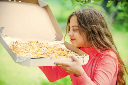 who cares about diet. her favorite food. junk food concept. happy child hold big pizza. meal delivery in time. hungry kid eating pizza. looking tasty and perfect. feel real hunger