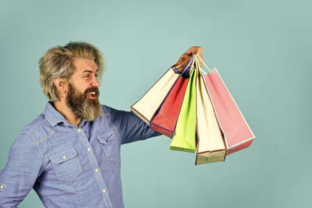 savings on purchases. Joyful man enjoying online shopping. happy hipster after shopping. bearded brutal man hold packages. ready to celebrate holidays. male fashion sale